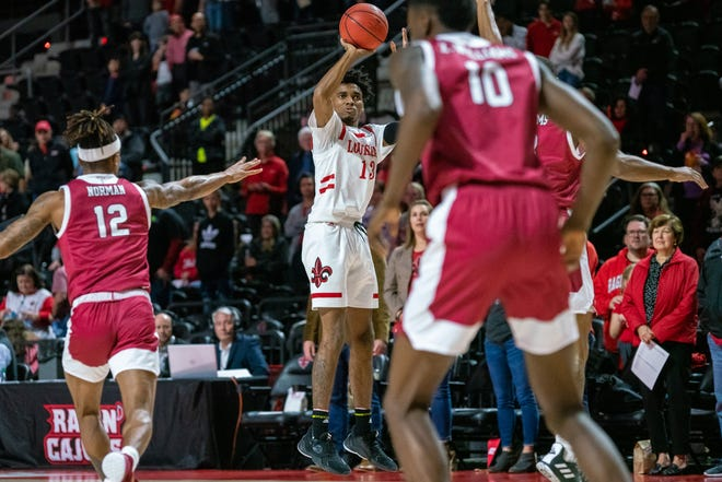 UL's Mylik Wilson attempts a shot from the three-point line as the Ragin' Cajuns take on the Troy Trojans at the Cajundome on Saturday, Jan. 4, 2020.