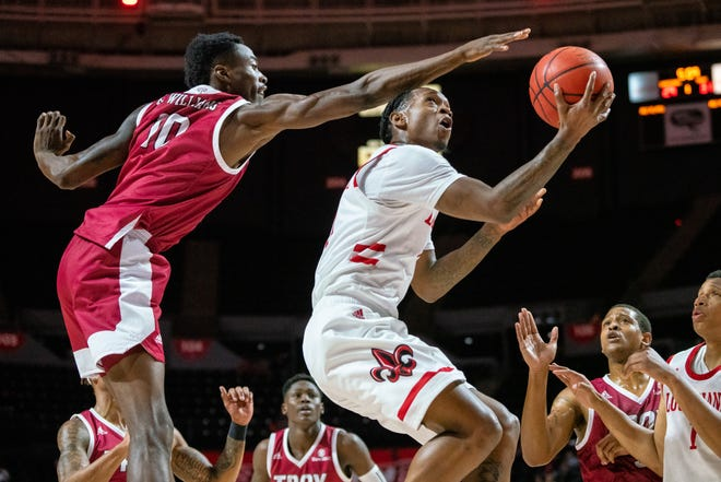 UL's Cedric Russell scores from under the basket as the Ragin' Cajuns take on the Troy Trojans at the Cajundome on Saturday, Jan. 4, 2020.