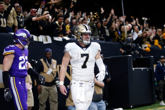New Orleans Saints quarterback Taysom Hill (7) smiles after spring on a touchdown reception against Minnesota Vikings free safety Harrison Smith (22) in the second half of an NFL wild-card playoff football game, Sunday, Jan. 5, 2020, in New Orleans. (AP Photo/Brett Duke)