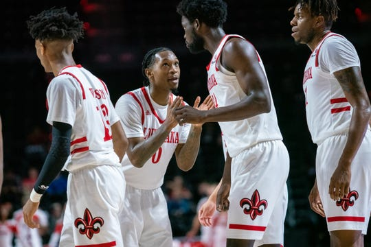 UL's Cedric Russell encourages his teammates after a timeout as the Ragin' Cajuns take on the Troy Trojans at the Cajundome on Saturday, Jan. 4, 2020.