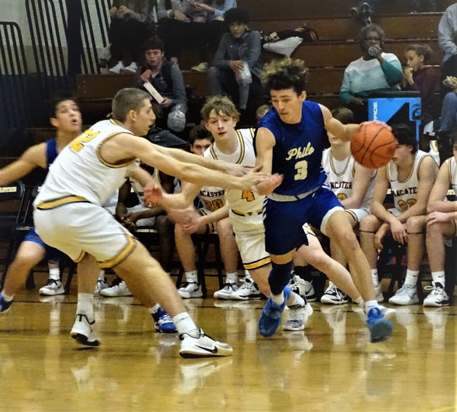Philo's Owen Smith dribbles against Lancaster's Tanner Roush and Dylan West during the Golden Gales' 72-38 non-conference win Saturday night.