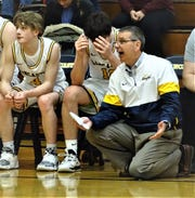 Lancaster coach Kent Riggs barks out instructions to his team during the Golden Gales' 72-38 win over Philo Saturday night.