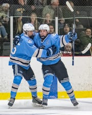 Livonia Stevenson's Seth Lause (right) celebrates one of his three shorthanded goals with teammate Adam Heard in a 5-2 victory over Hartland on Saturday, Jan. 4, 2020.