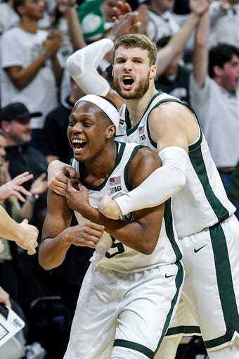 Michigan State's Cassius Winston, left, and Kyle Ahrens celebrate after a Michigan technical foul during the second half on Sunday, Jan. 5, 2020, at the Breslin Center in East Lansing.