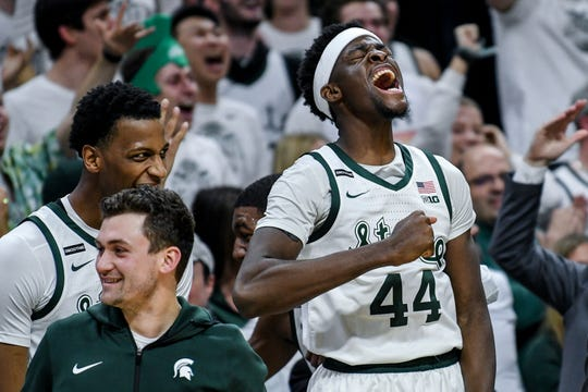 Michigan State's Gabe Brown celebrates on the bench during the second half on Sunday, Jan. 5, 2020, at the Breslin Center in East Lansing.
