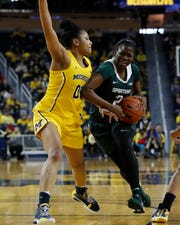 Michigan State forward Mardrekia Cook (2) drives on Michigan forward Naz Hillmon (00) during the second half of an NCAA college basketball game, Sunday, Jan. 5, 2020, in Ann Arbor, Mich. (AP Photo/Carlos Osorio)
