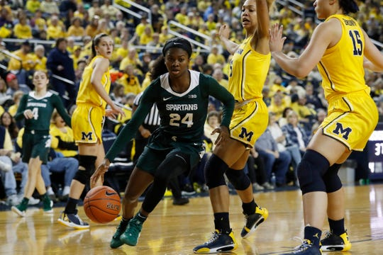 Michigan State guard Nia Clouden (24) drives during the second half of an NCAA college basketball game against Michigan, Sunday, Jan. 5, 2020, in Ann Arbor, Mich. (AP Photo/Carlos Osorio)