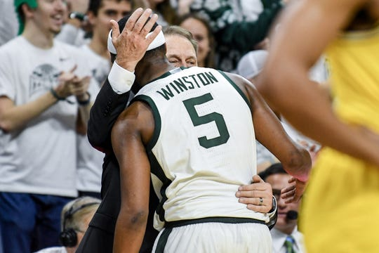 Michigan State's head coach Tom Izzo hugs Cassius Winston late during the second half on Sunday, Jan. 5, 2020, at the Breslin Center in East Lansing.