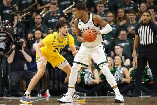 Jan 5, 2020; East Lansing, Michigan, USA;  Michigan State Spartans forward Xavier Tillman (23) is defended by Michigan Wolverines forward Brandon Johns Jr. (23) during the first half a game at the Breslin Center. Mandatory Credit: Mike Carter-USA TODAY Sports