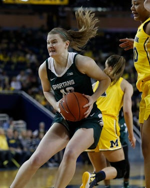 Michigan State guard Julia Ayrault (40) pulls down a rebound during the second half of an NCAA college basketball game against Michigan, Sunday, Jan. 5, 2020, in Ann Arbor, Mich. (AP Photo/Carlos Osorio)