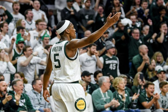 Michigan State's Cassius Winston celebrates after a 3-pointer during the second half on Sunday, Jan. 5, 2020, at the Breslin Center in East Lansing.