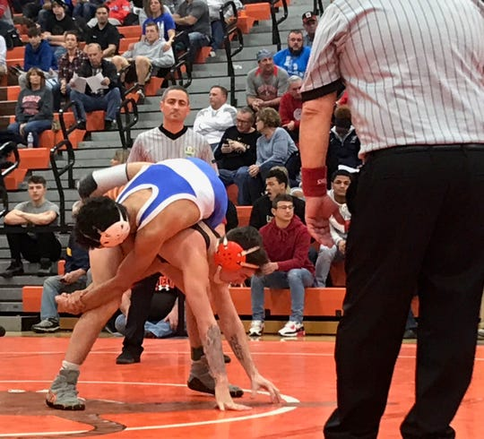 Mansfield Senior's Josh Lyons gets to his feet en route to winning the 132 pound title 6-5 over returning champ Howard Williams of East Liverpool in the 58th J.C. Gorman Invitational.