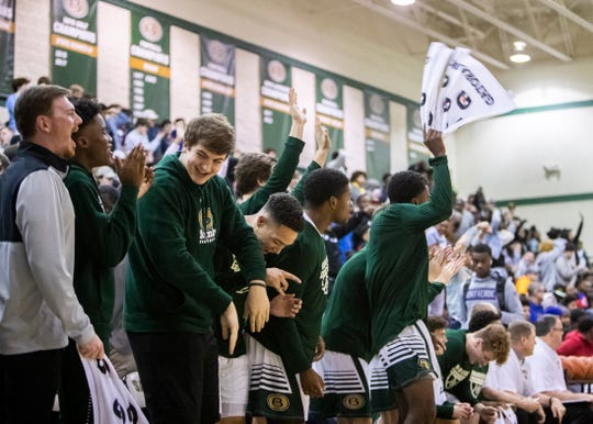 Briarcrest bench celebrates during the National Hoopfest on Jan. 4, 2020 in Eads, TN.