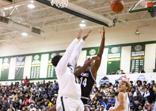 IMG forward Moussa Diabate(14) shoots over Briarcrest center Rodney Newsome (13) during the National Hoopfest on Jan. 4, 2020 in Eads, TN.