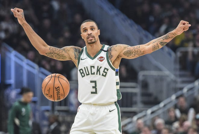 Bucks guard George Hill calls a play in the second quarter Saturday night.