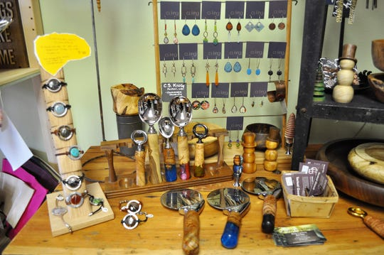 Handmade jewelry from Mondovi artist C.S. King and wooden creations from Stockholm artist Matt Sime are among the locally crafted items found at the Purple Turtle Artisan Collective in Brown Deer.