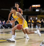 UW-Milwaukee guard Te'Jon Lucas drives to the basket against Illinois-Chicago in a Horizon League basketball game  Sunday, January 5, 2020, at the UW-Milwaukee Panther Arena in Milwaukee, Wisconsin.
