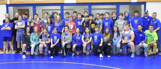 Members of the Bombers and Lady Bombers pose for a photograph after the Bomber Battle wrestling tournament on Saturday.