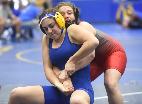 Mountain Home's Laurel Chafin works to break the hold of West Plains' Brianna Cowherd on Saturday.