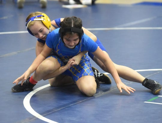 Mountain Home's Danielle Frencl and Sarah Montelongo compete in a 116-pound match last weekend at the Bomber Battle tournament.