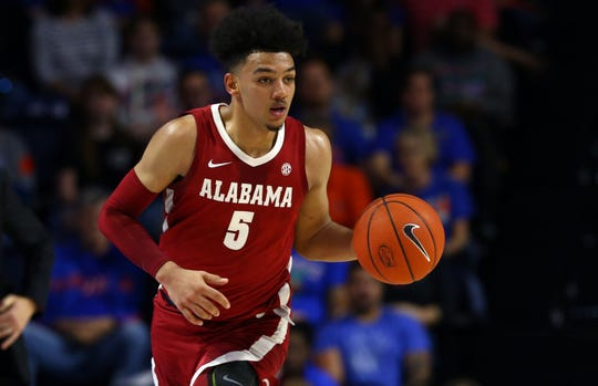 Jan 4, 2020; Gainesville, Florida, USA;Alabama Crimson Tide guard Jaden Shackelford (5) drives to the basket against the Florida Gators  during the first half at Exactech Arena. Mandatory Credit: Kim Klement-USA TODAY Sports
