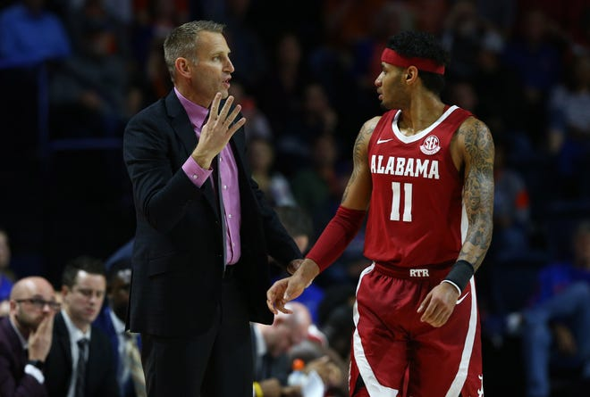 Jan 4, 2020; Gainesville, Florida, USA; Alabama Crimson Tide head coach Nate Oats talks with guard James Bolden (11) against the Florida Gators during the first half at Exactech Arena. Mandatory Credit: Kim Klement-USA TODAY Sports