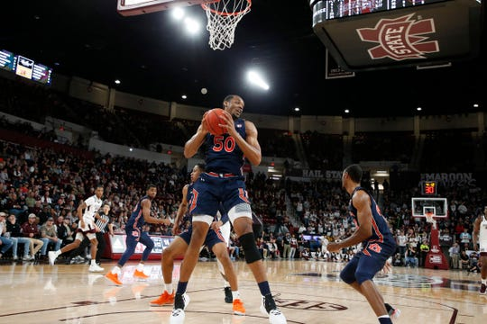 Auburn center Austin Wiley (50) pulls down a rebound against Mississippi State during the first half of an NCAA college basketball game, Saturday, Jan. 4, 2020, in Starkville, Miss. (AP).