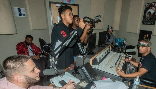 The late Doe B's manager Frank White, left,  and music producer Bao Pham are interviewed by DJ Frosty, right, of Montgomery's Hot 105.7.