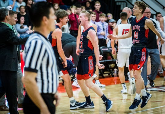 Blue River Valley's Andrew Froedge celebrates at the end of a quarter against Wapahani during their game at Wapahani High School Saturday, Jan. 4, 2020.