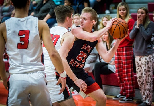 Blue River Valley's Andrew Froedge looks for a teammate during their game against Wapahani at Wapahani High School Saturday, Jan. 4, 2020.