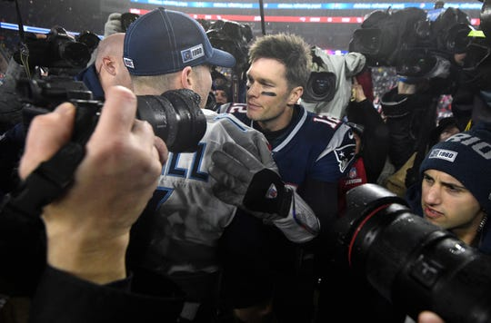 New England Patriots quarterback Tom Brady (12) chats with Tennessee Titans quarterback Ryan Tannehill (17) after the Titans' 20-13 win in an AFC Wild Card game at Gillette Stadium Saturday, Jan. 4, 2020 in Foxborough, Mass.