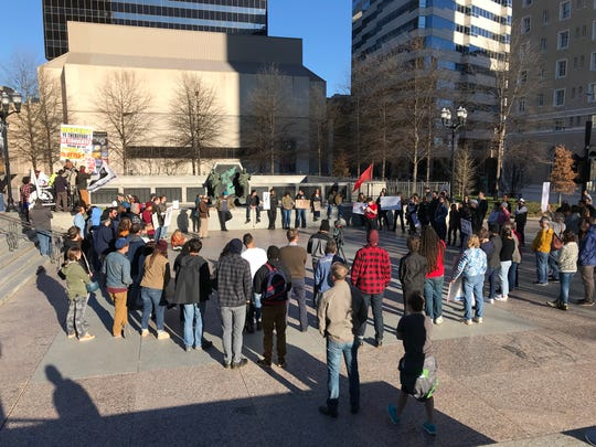 Anti-war protesters gather in downtown Nashville on Sunday, Jan. 5, 2020 in response to President Donald Trump's recent decision to kill an Iranian general.