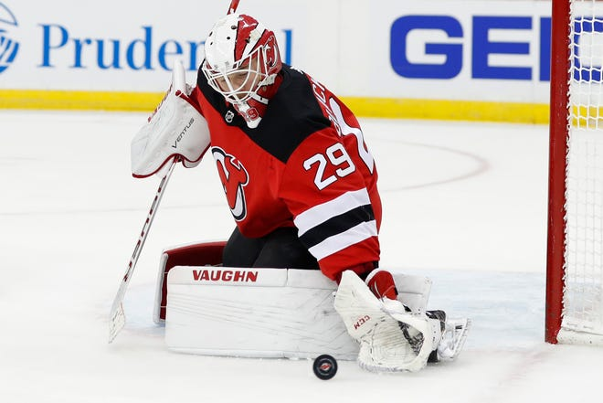 New Jersey Devils goaltender Mackenzie Blackwood makes a save during the first period of the team's NHL hockey game against the Colorado Avalanche, Saturday, Jan. 4, 2020, in Newark, N.J.