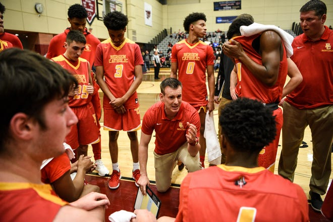 Bergen Catholic plays Hudson Catholic at the Dennis Gregory Memorial Classic basketball game at Ramapo College in Mahwah on Saturday January 4, 2020. Bergen Catholic Head Coach Billy Armstrong talks to the team during a break in the action.