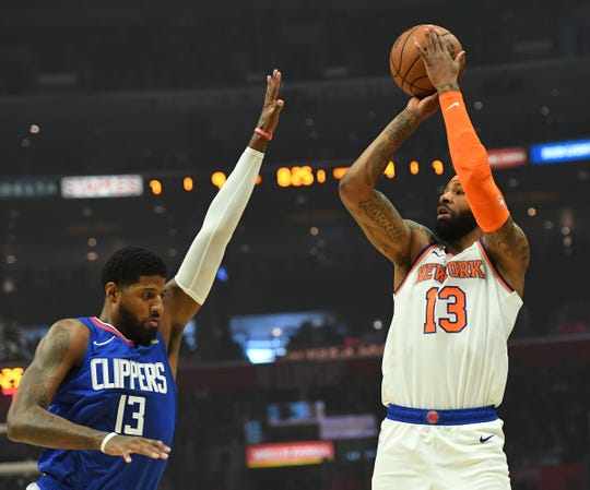 Jan 5, 2020; Los Angeles, California, USA;  Los Angeles Clippers forward Paul George (13) defends a shot by New York Knicks forward Marcus Morris Sr. (13) in the first quarter of the game at Staples Center. Mandatory Credit: Jayne Kamin-Oncea-USA TODAY Sports