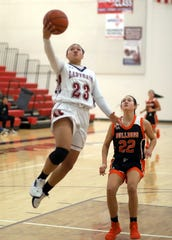 Sophomore Lady 'Cat Harmanie Dominguez (23) found a clear lane to the basket on Saturday against Artesia. Dominguez led all scorers with 17 points.