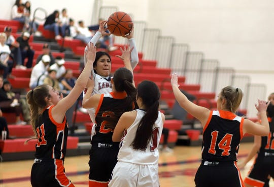 Junior Lady 'Cat Jenae Jasso (with ball) had a strong rebounding game against Artesia High on Saturday.