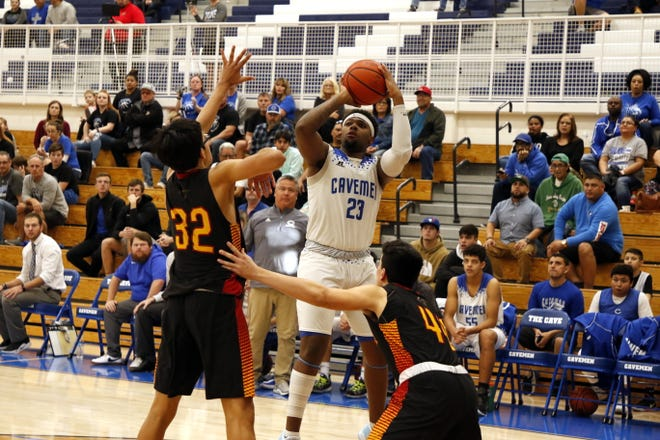 Carlsbad's Shamar Smith shoots over Centennials' Jesus Luna-Alvarado in the fourth quarter of their game on Jan. 4, 2020. Smith scored 19 points and Carlsbad won, 40-39.