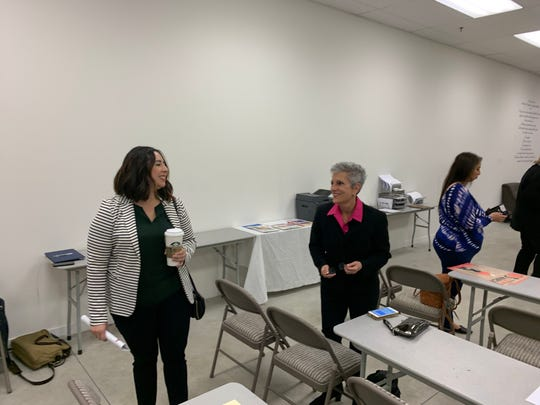 Elizabeth Romero and Joy Silver speak before Democratic Party delegates vote to endorse in the 2020 special election to replace State Senator Jeff Stone in Palm Desert, Calif. on Jan. 4, 2020.