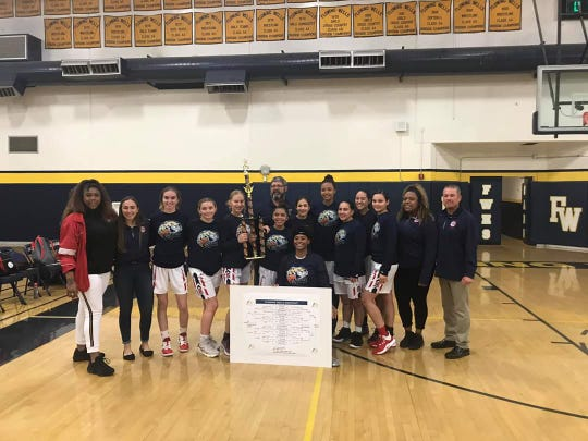 Dec. 28, 2019; Sahuaro girls basketball team stands with championship trophy after winning the Flowing Wells Shootout