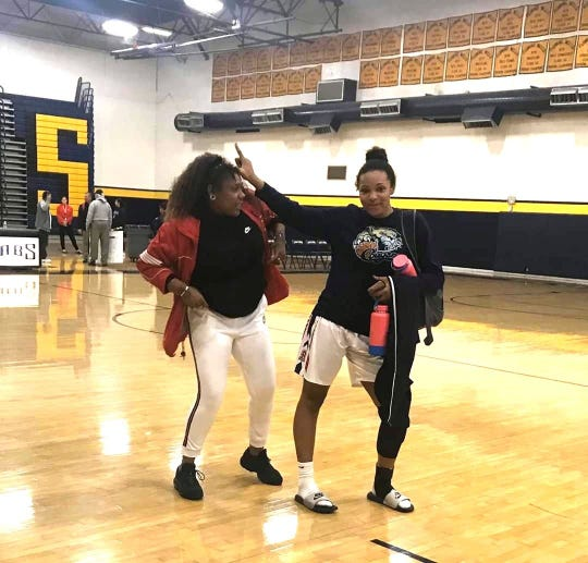 Dec. 28, 2019; Sahuaro girls basketball assistant coach Sydney Harden celebrates with junior forward and sister Alyssa Brown after winning the Flowing Wells Shootout tournament.