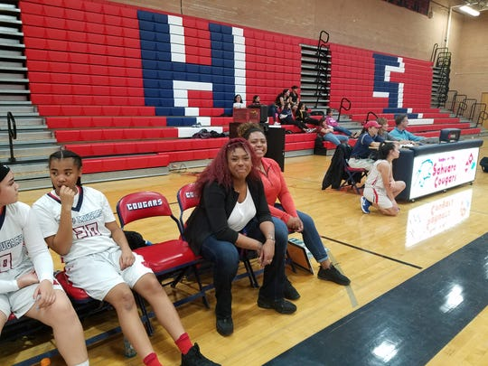 Sahuaro girls basketball assistant coaches Sydney Harden and Olivia Harden on the sidelines during a game.