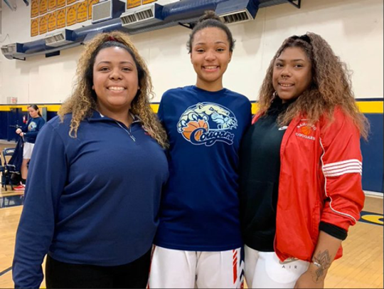 Dec. 28, 2019; (L to R) Sahuaro girls basketball assistant coach Olivia Harden, forward Alyssa Brown, and assistant coach Sydney Brown stand as sisters celebrating her setting the school scoring record at Flowing Wells Shootout.