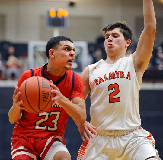 Lebanon's Marquis Ferreira (23) drives to the basket as Palmyra's Kasey Shughart (2) defends during fourth quarter action.