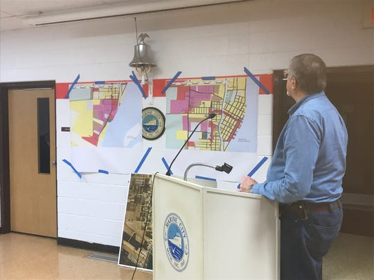 Joe Moran, chairman of Marine City's planning commission, points out where in the community certain setbacks and what zoning would allow for recreational marijuana businesses during a City Commission meeting on Dec. 16, 2019.