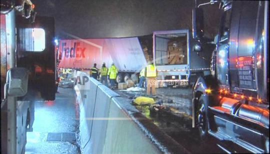 The scene of a major crash on the Pa. Turnpike in Westmoreland County that claimed the lives of five people.  The crash involved a passenger bus, three tractor-trailers and a passenger vehicle.