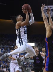 Nevada's Jazz Johnson (22) shoots while taking on Boise St. during their basketball game at Lawlor Events Center in Reno on Jan. 4, 2020.