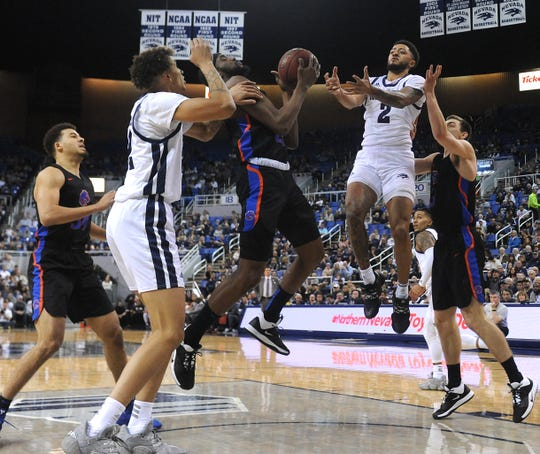 Nevada's Jalen Harris (2) fights for the ball while taking on Boise St. during their basketball game at Lawlor Events Center in Reno on Jan. 4, 2020.