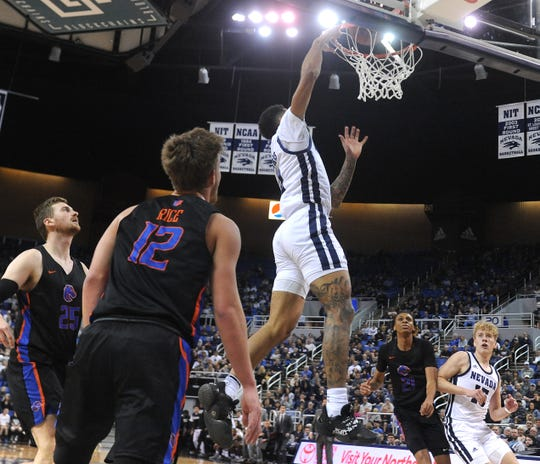 Nevada's Jalen Harris (2) dunks while taking on Boise St. during their basketball game at Lawlor Events Center in Reno on Jan. 4, 2020.