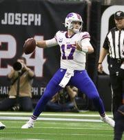 Bills quarterback Josh Allen steps into a throw.